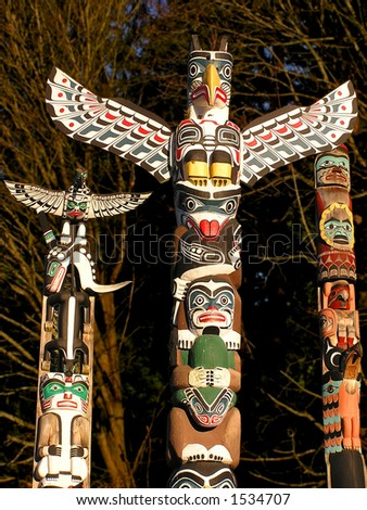 North American Indian painted totem poles in Vancouver - stock photo