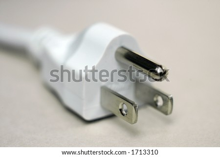 North American type 3 pin electical plug in close-up with shallow DOF