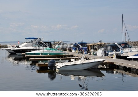 North Bay, Ontario, Canada - August 17, 2015: Boats  are docked at North Bay's waterfront. - stock photo