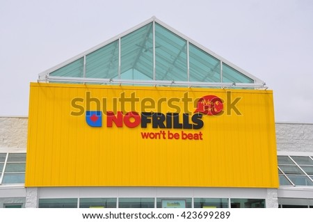 North Bay, Ontario, Canada - May 18, 2016: Facade of Mike and Lori No Frills grocery store in North Bay. - stock photo