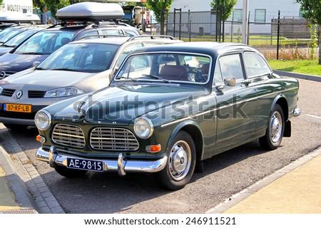 NORTH BRABANT, NETHERLANDS - AUGUST 9, 2014: Swedish retro car Volvo Amazon at the interurban road. - stock photo