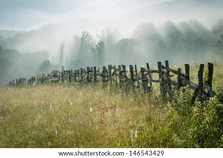 North Carolina Blue Ridge Parkway Fence Morning Sun Rays - stock photo