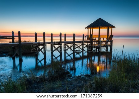 North Carolina coastal gazebo stretches into Pamlico Sound during a summer sunset - stock photo