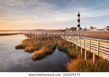 North Carolina Outer Banks Bodie Island Lighthouse Autumn Morning Marsh Boardwalk - stock photo