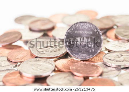 North Carolina State Quarter with other coins close up  - stock photo