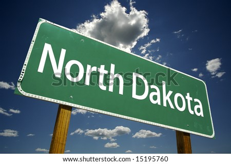 North Dakota Road Sign with dramatic clouds and sky. - stock photo