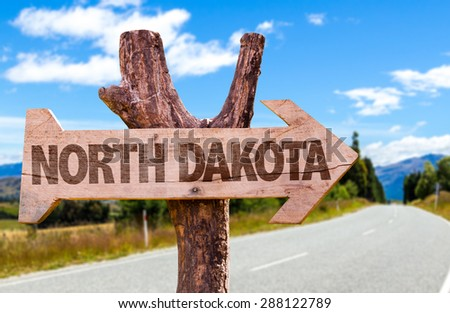 North Dakota wooden sign with road background - stock photo