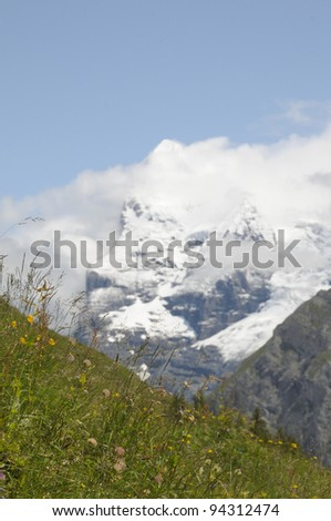 North Face of the Eiger in fresh summer snow from Allmendhubel