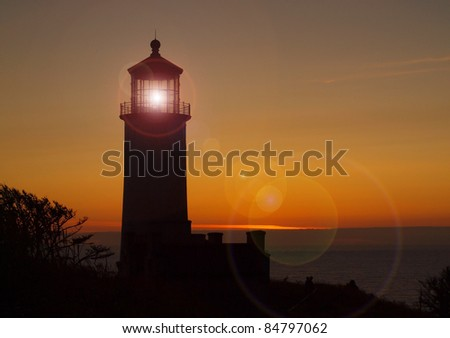North Head Lighthouse on the Washington Coast at Sunset - stock photo