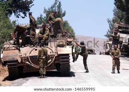 NORTH ISRAEL - JULY 26:Israeli soldiers and tanks on Israel Lebanon border on July 26 2006. In the conflict 165 Israelis where killed and 500,000 displaced. - stock photo
