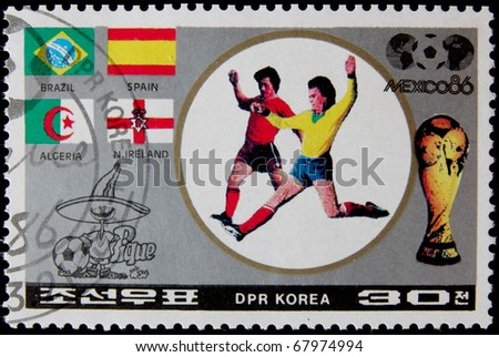 NORTH KOREA - CIRCA 1986:A post stamp printed in North Korea, shows football players, devoted Football World Cup Championship, Mexico City, series. circa 1986.