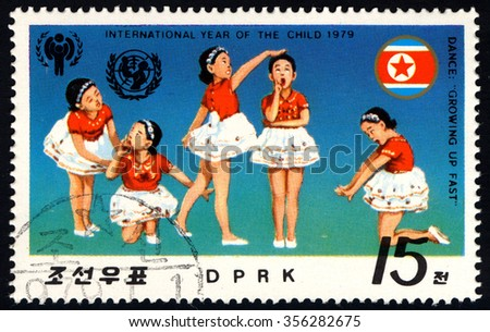 NORTH KOREA - CIRCA 1979: A stamp printed in DPRK dedicated to International year of the Child (II) shows Children Dancing Performance â?? Growing Up Fast, circa 1979 - stock photo