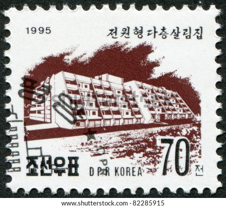 NORTH KOREA - CIRCA 1995: A stamp printed in North Korea shows a block of flats on Kwangbok Street in Pyongyang, circa 1995