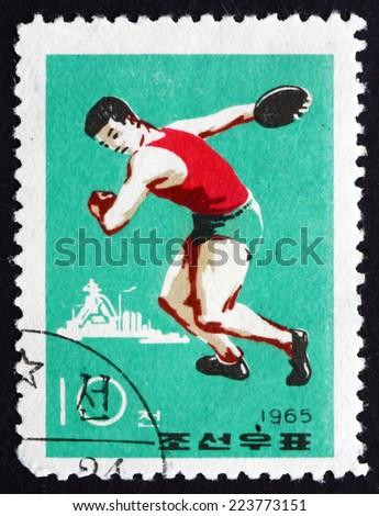 NORTH KOREA - CIRCA 1965: a stamp printed in North Korea shows Discus Throw, Sport, circa 1965 - stock photo