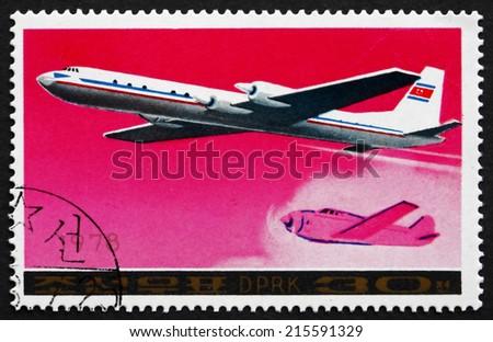 NORTH KOREA - CIRCA 1978: a stamp printed in North Korea shows Ilyushin Il-18 Airliner and '30s-era Airplane, circa 1978 - stock photo