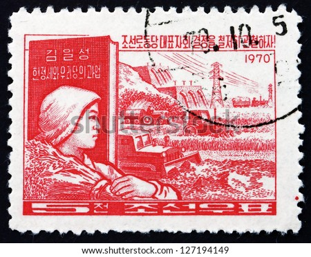 NORTH KOREA - CIRCA 1970: a stamp printed in North Korea shows Peasant and Farm Scene, Workers'?? Party Program, circa 1970 - stock photo