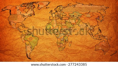 north korea flag on old vintage world map with national borders - stock photo