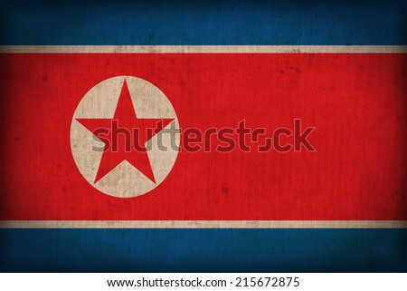 North Korea flag pattern on the fabric texture ,retro vintage style - stock photo