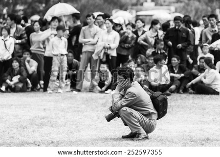 NORTH KOREA - MAY 1, 2012: Korean people watch the public games due to the celebration of the International Worker's Day in N.Korea, May 1, 2012. May 1 is a national holiday in 80 countries