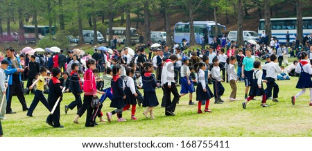 NORTH KOREA - MAY 1, 2012: Pioneer children in the park due to the celebrating of the International Worker's Day in N.Korea, May 1, 2012. May 1 is a national holiday in 80 countries