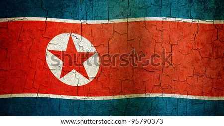 North Korean flag on a cracked grunge background - stock photo