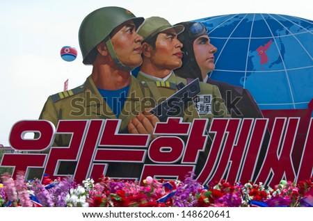 North Korean soldiers placard at the military parade in Pyongyang.  Pyongyang, North Korea, July 2013. - stock photo