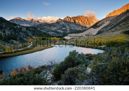 North Lake in the Sierra Nevada Mountains at sunrise in the fall with yellow aspen trees - stock photo