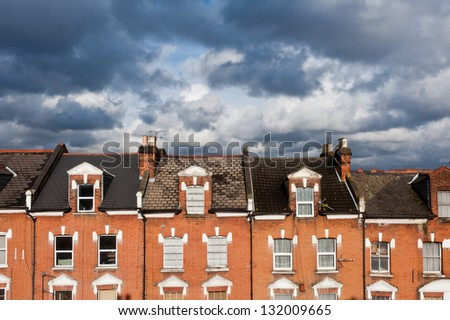 North London houses against cloudy sky - stock photo