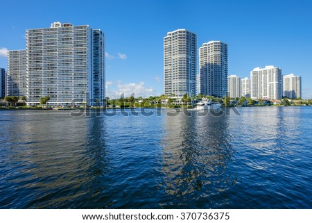 North Miami Intracoastal Waterway with a yacht cruising by and condominiums. - stock photo