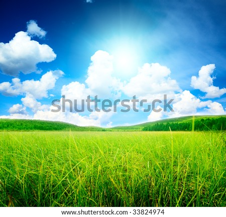 north mountains and green grass - stock photo