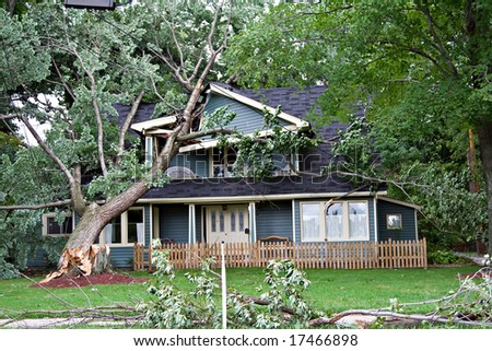NORTH OLMSTEAD, OHIO, September 15, 2008.: The Ike hurricane traveled the United States. North Olmsted a Cleveland suburb in Ohio received damaging winds - tree falls on a suburban home - stock photo