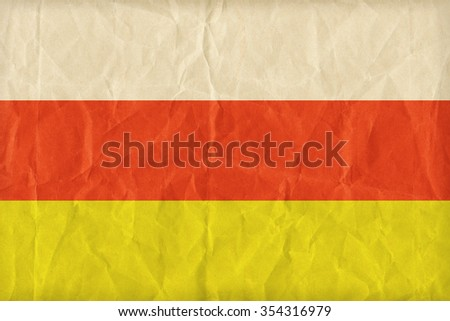 North Ossetia-Alania Republic flag pattern on paper texture,retro vintage style