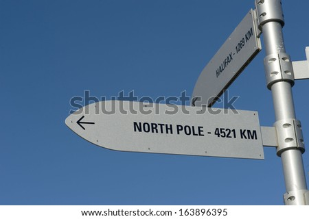 north pole and halifax Signpost - stock photo