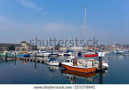 North Quay marina Weymouth Dorset UK with boats and yachts on a calm peaceful summer day with blue sky - stock photo