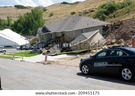NORTH SALT LAKE (UT) / USA - august 8, 2014: A police car was destroyed by a landslide in the house - stock photo