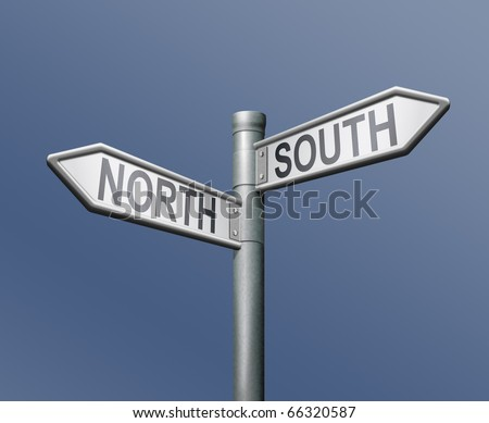 north south road sign on blue background opposite direction opposites contrast choice crossroads - stock photo