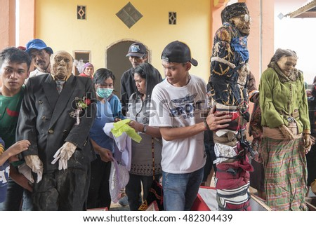 North Toraja, Sulawesi,Indonesia-Aug 26, 2016:The dead body to bring up by the relatives to clean off their corpses, and dress them as part of the bizarre Ma'nene festival in Bagan Pangala village.