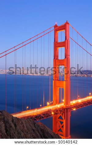 North tower of Golden Gate Bridge glows in the dusk - stock photo