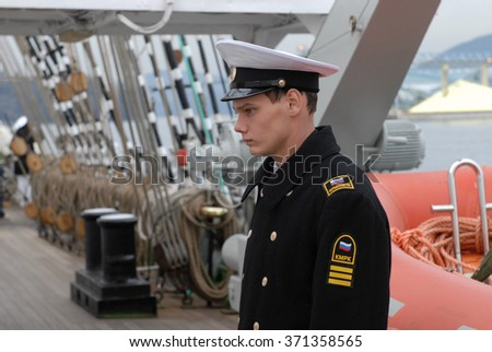 "NORTH VANCOUVER, CANADA - FEBRUARY 24, 2010: Cadet of Russian Bark ""Kruzenstern"" is on duty on Feb.24, 2010 in North Vancouver, Canada."