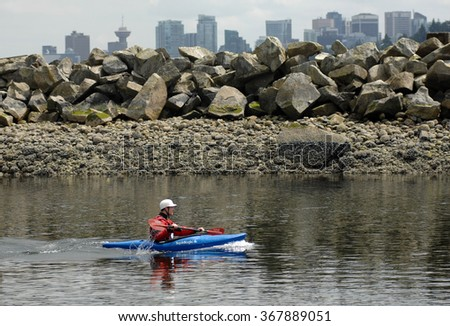 NORTH VANCOUVER, CANADA - JUNE 8, 2013: Athletes compete during 2013 North Shore kayak endurance race in North Vancouver, Canada, June 8, 2013.  - stock photo
