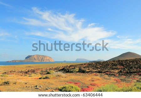North-Western edge of Island Graciosa with an ancient volcano on the right and Island Montana Clara across the water. Canary islands, Spain - stock photo
