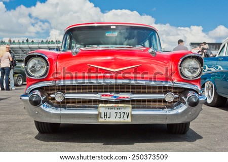 NORTHAMPTONSHIRE, UK- JULY 15: A red vintage Chevrolet Bel Air in a Show on show at the Dragstalgia Classic American car event on July 15, 2012 at Santa Pod Raceway in Northamptonshire, UK.