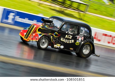 """NORTHAMPTONSHIRE, UK - JULY 15 2012: Alan O'Conner drive his dragster """"Al's Gasser"""" at the Dragstalgia event at Santa Pod Raceway on 15th July.2012 - stock photo"""