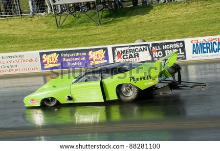 NORTHAMPTONSHIRE, UK - OCT 29: Sleek Plymouth Superbird Pro Mod funny car on the strip at the Flame and Thunder drag-racing event on Oct 29, 2011 at Santa Pod Raceway in Northamptonshire, UK - stock photo