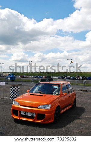 NORTHANTS, ENGLAND - JULY 16: Modified Orange Ford Fiesta on July 16, 2008 in Northants, England, UK.  Santa Pod Drag Strip is Host to the Annual Street Nationals Automotive Show