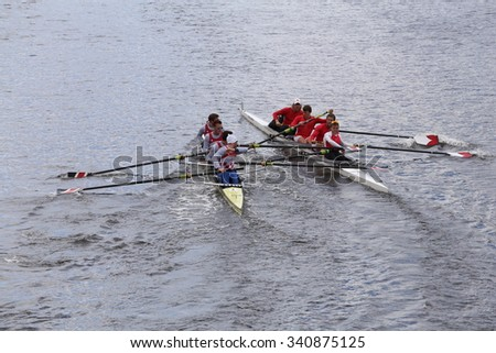 Northeastern (left) and Cornell(right) collide BOSTON - OCTOBER 18, 2015: races in the Head of Charles Regatta Mens's Championship Fours [PUBLIC RACE] - stock photo