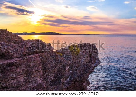 Northern Beauty. Sunset along the shores of Presque Isle Park in Marquette, Michigan. This beautiful park is located in the heart of Marquette. The Upper Peninsula's largest city. - stock photo