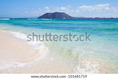 Northern Fuerteventura, Corralejo Flag Beach, Isla de Lobos and Lanzarote in the background - stock photo