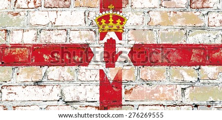 Northern Ireland flag painted on old brick wall texture background - stock photo