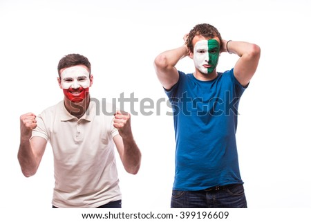 Northern Ireland vs Poland. Football fans of national teams demonstrate emotions: Northern Ireland lose, Poland win. European  football fans concept. - stock photo